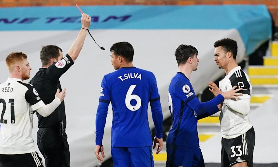 Fulham's Antonee Robinson is shown a straight red card for a challenge on Chelsea's César Azpilicueta just before half-time