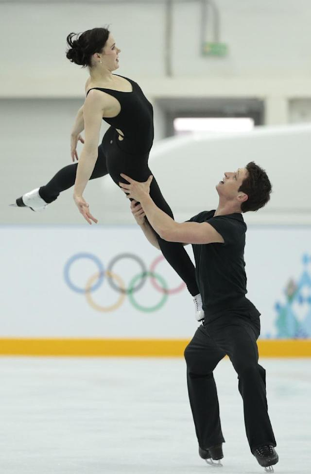 Canada's Tessa Virtue and Scott Moir skate at the figure skating practice rink ahead of the 2014 Winter Olympics, Wednesday, Feb. 5, 2014, in Sochi, Russia. (AP Photo/Ivan Sekretarev)