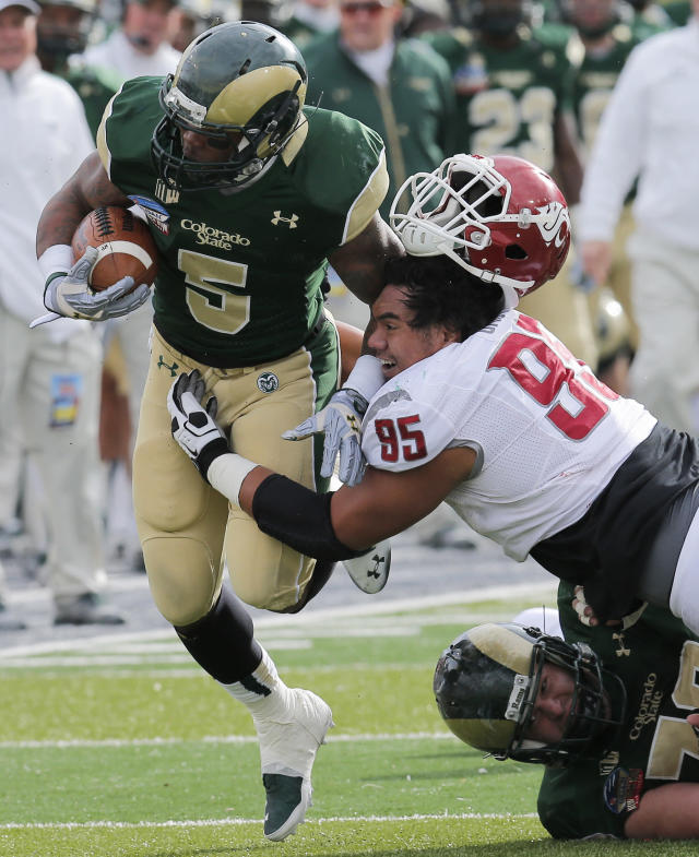 Washington State nose tackle Ioane Gauta (95) loses his helmet as he hits Colorado State running back Kapri Bibbs (5) during the first half of the New Mexico Bowl NCAA college football game, Saturday, Dec. 21, 2013, in Albuquerque, N.M. (AP Photo/Matt York)