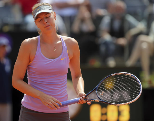 Russia's Maria Sharapova reacts after losing a point during her match against Serbia's Ana Ivanovic at the Italian open tennis tournament in Rome, Thursday, May 15, 2014. (AP Photo/Gregorio Borgia)
