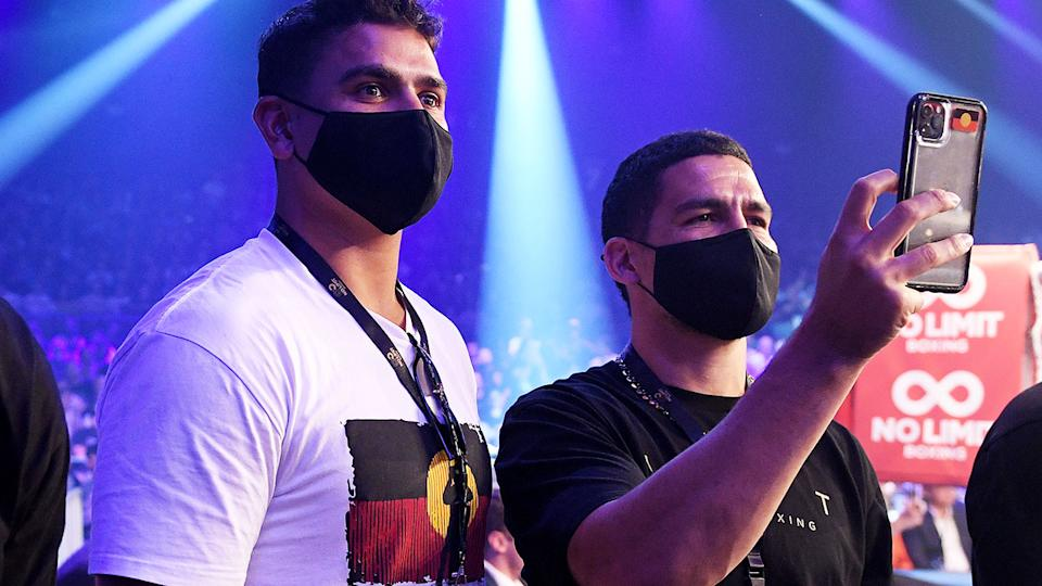 Latrell Mitchell and Cody Walker, pictured here at the Tim Tszyu fight.
