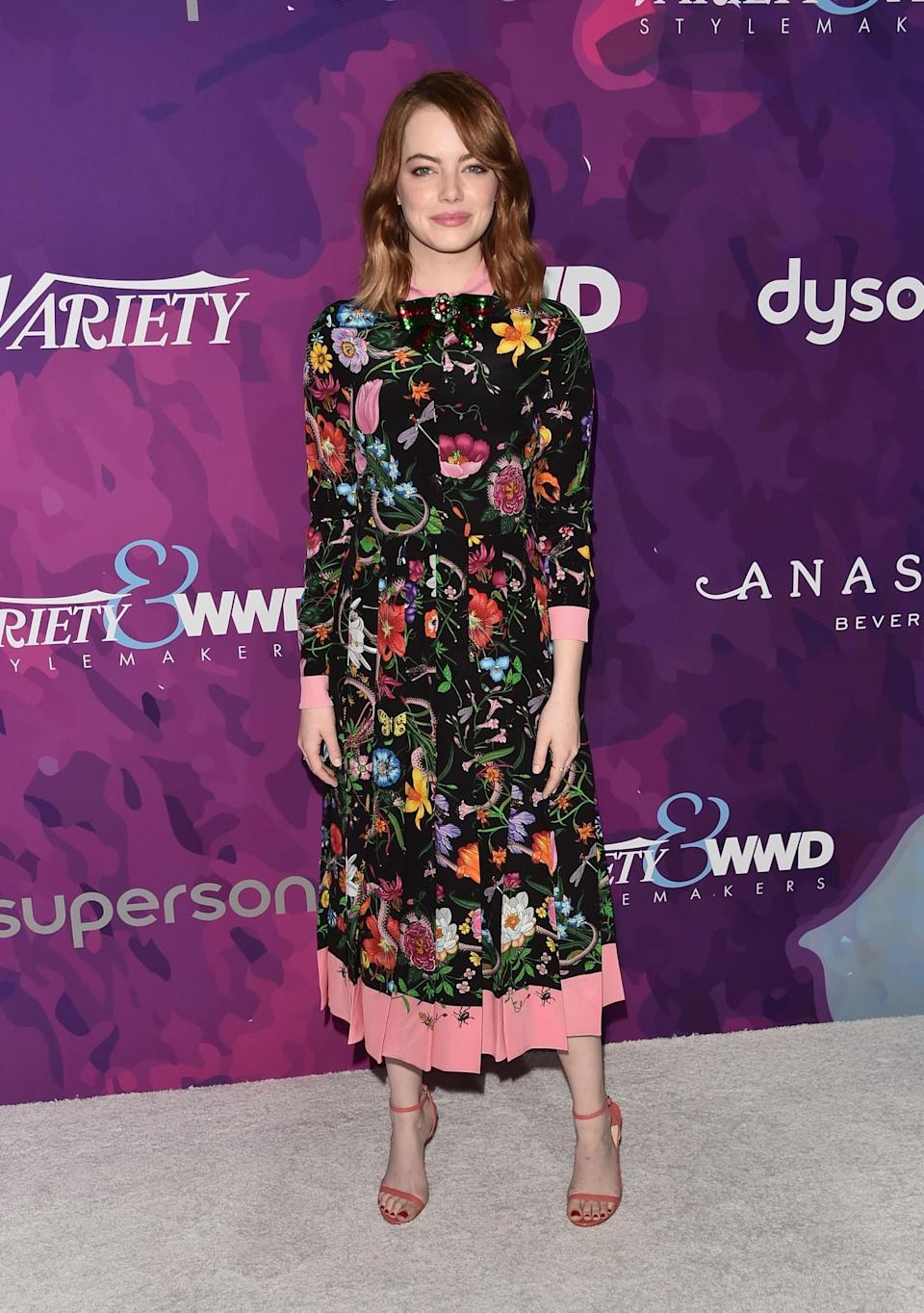 <p>Only Emma could pull off a pleated floral dress featuring actual spiders without looking insane. <i>[Photo: Getty]</i> </p>