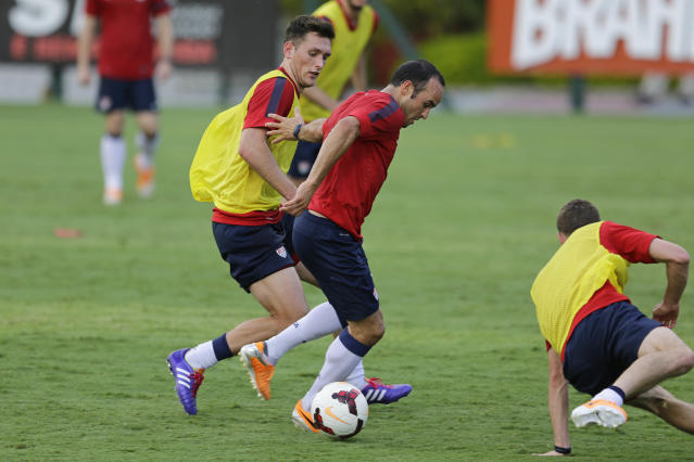 United States' Landon Donavan fights for the ball with Matt Besler, left, during a training session in Sao Paulo, Brazil, Tuesday, Jan. 14, 2014. The US national soccer team is on a 10-day training program in Sao Paulo preparing for the World Cup tournament, which gets underway on June 12. (AP Photo/Nelson Antoine)