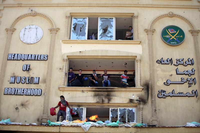 Protesters ransack the Muslim Brotherhood headquarters in the Muqatam district in Cairo, Monday, July 1, 2013. Protesters stormed and ransacked the headquarters of President Mohammed Morsi's Muslim Brotherhood group early Monday, in an attack that could spark more violence as demonstrators gear up for a second day of mass rallies aimed at forcing the Islamist leader from power. (AP Photo/Khalil Hamra)
