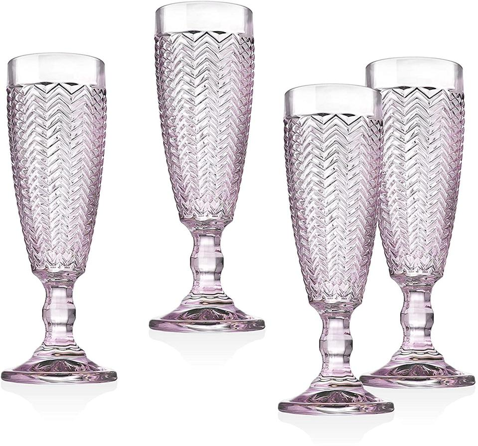 <p>These <span>Godinger Twill Champange Flutes</span> ($27) are so elegant.</p>