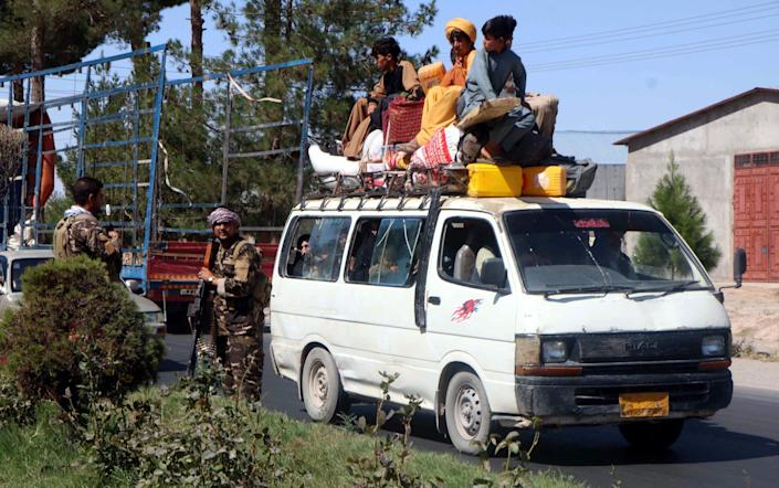 People flee Herat following intense fighting between Taliban militants and the Afghan special forces - Jalil Rezayee/Shutterstock