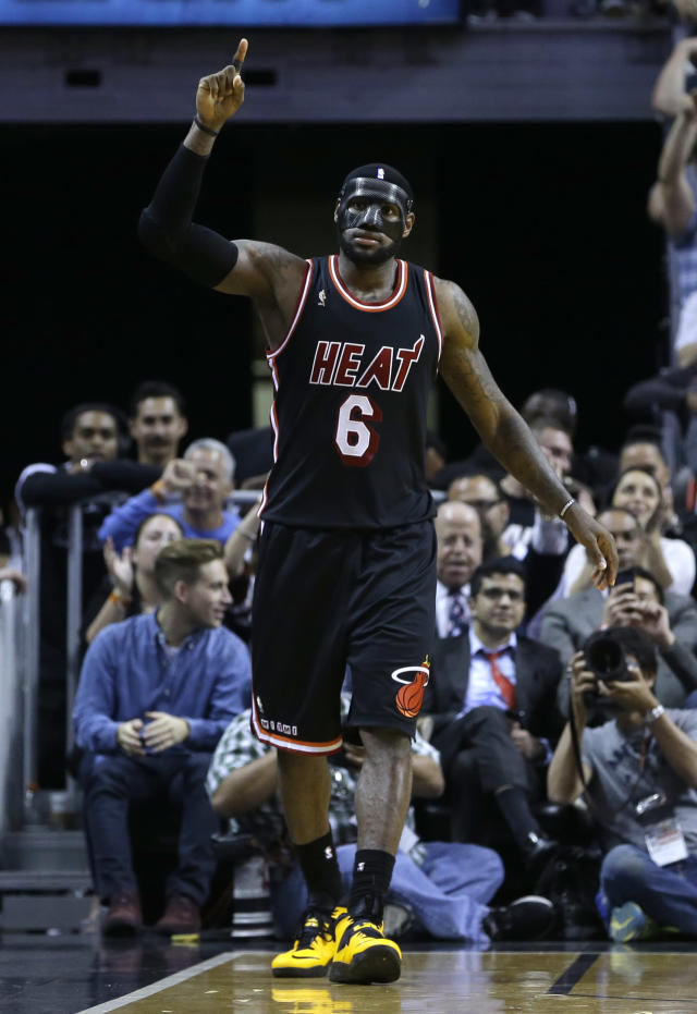 Miami Heat small forward LeBron James (6) celebrates after scoring against the New York Knicks during the second half of an NBA basketball game in Miami, Thursday, Feb. 27, 2014. Miami won 108-82. (AP Photo/Alan Diaz)
