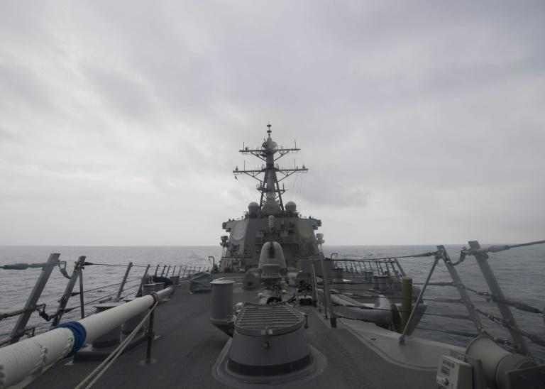 The US military has been using guided-missile destroyers like this one, the USS John McCain, seen here in a US Navy photo, as it seeks to enforce an international 'freedom of operation' near islands claimed by Beijing in the South China Sea