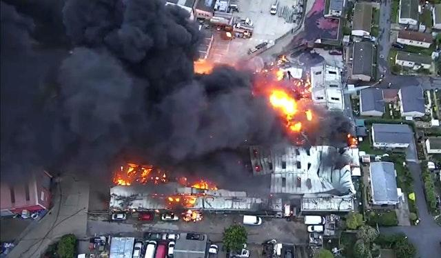 A huge blaze that firefighters have been battling at an industrial building in Hoo, near Rochester, Kent