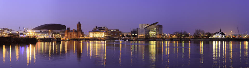 A tranquil scene of Cardiff Bay on a calm evening. In this city scape you can see the Pierhead building (1897) and National Assembly for Wales with the Bay in the foreground.The photograph was taken at dusk using a tripod and a long exposure using a panoramic tripod head.