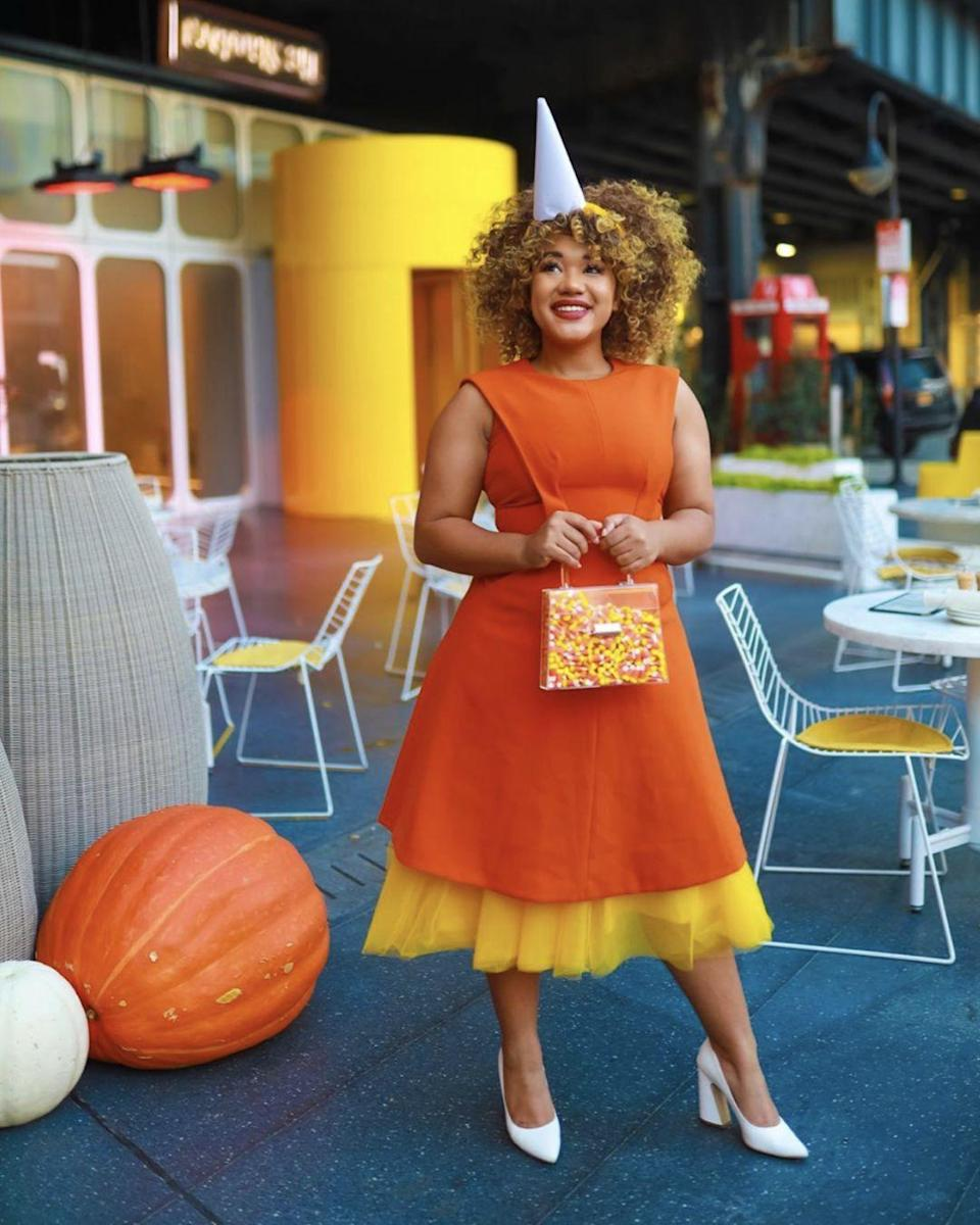 """<p>Talk about a sweet costume. This easy-to-execute candy corn outfit pays homage to one of Halloween's most iconic candies. </p><p><strong>Get the tutorial at <a href=""""https://www.colormecourtney.com/food-themed-costumes/"""" rel=""""nofollow noopener"""" target=""""_blank"""" data-ylk=""""slk:Color Me Courtney"""" class=""""link rapid-noclick-resp"""">Color Me Courtney</a>. </strong></p><p><strong><a class=""""link rapid-noclick-resp"""" href=""""https://www.amazon.com/dp/B071WVKZML/ref=asc_df_B01MZXAESI5489044/?creative=395033&creativeASIN=B01MZXAESI&linkCode=df0&tag=syn-yahoo-20&ascsubtag=%5Bartid%7C10050.g.4571%5Bsrc%7Cyahoo-us&th=1"""" rel=""""nofollow noopener"""" target=""""_blank"""" data-ylk=""""slk:SHOP ORANGE DRESS"""">SHOP ORANGE DRESS</a><br></strong></p>"""