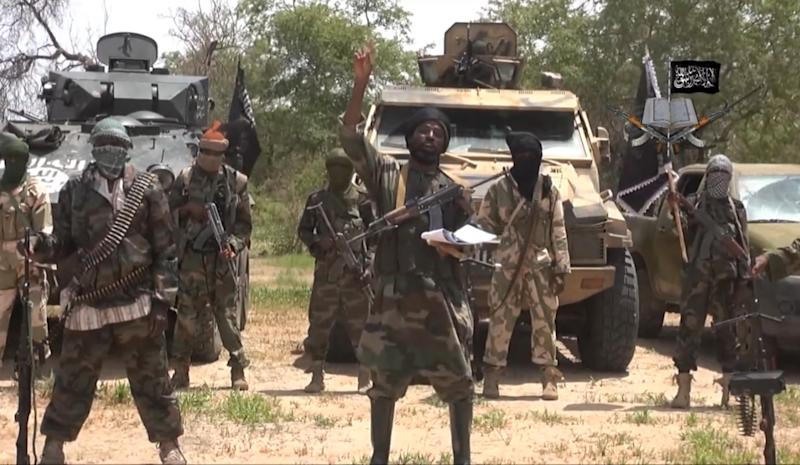 A screengrab taken on July 13, 2014 from a video released by the Nigerian Islamist extremist group Boko Haram and obtained by AFP shows the leader of the Nigerian Islamist extremist group Boko Haram, Abubakar Shekau (C) (AFP Photo/)