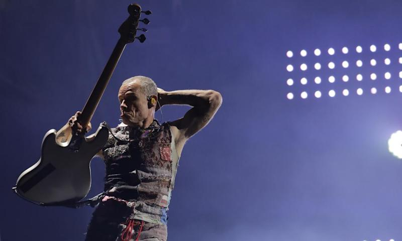 Flea playing bass with the Red Hot Chili Peppers