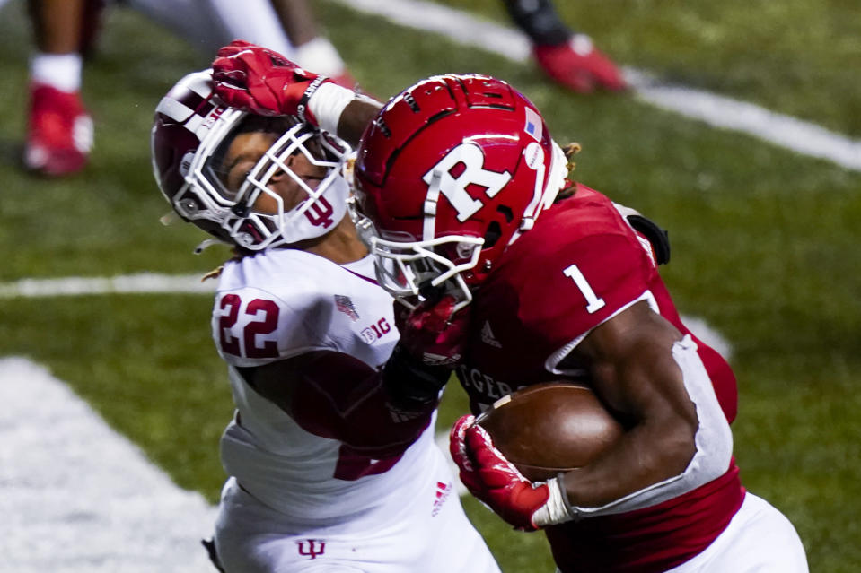 Rutgers running back Isaih Pacheco (1) holds off Indiana defensive back Jamar Johnson (22) in the fourth quarter of an NCAA college football game, Saturday, Oct. 31, 2020, in Piscataway, N.J. (AP Photo/Corey Sipkin)