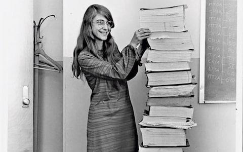 Margaret Hamilton standing next to the Apollo guidance software she and her team developed, 1969 - Credit: Courtesy MIT Museum