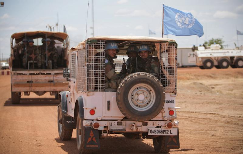 """In this photo taken Tuesday, May 24, 2011 and released May 25 by the United Nations Mission in Sudan (UNMIS), the first of 125 Indian soldiers serving with the international peacekeeping force arrive in Abyei, Sudan. Gunmen from an Arab tribe fired on four U.N. helicopters taking off from Abyei, a disputed north-south Sudan border town, an official said Wednesday, May 25, 2011, while Sudan's president gave northern troops a """"green light"""" to attack southern forces if provoked. (AP Photo/UNMIS, Stuart Price) EDITORIAL USE ONLY, NO SALES"""