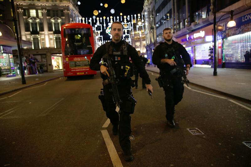 <strong>Armed police on Oxford Street after people reported hearing gunshots</strong> (DANIEL LEAL-OLIVAS via Getty Images)