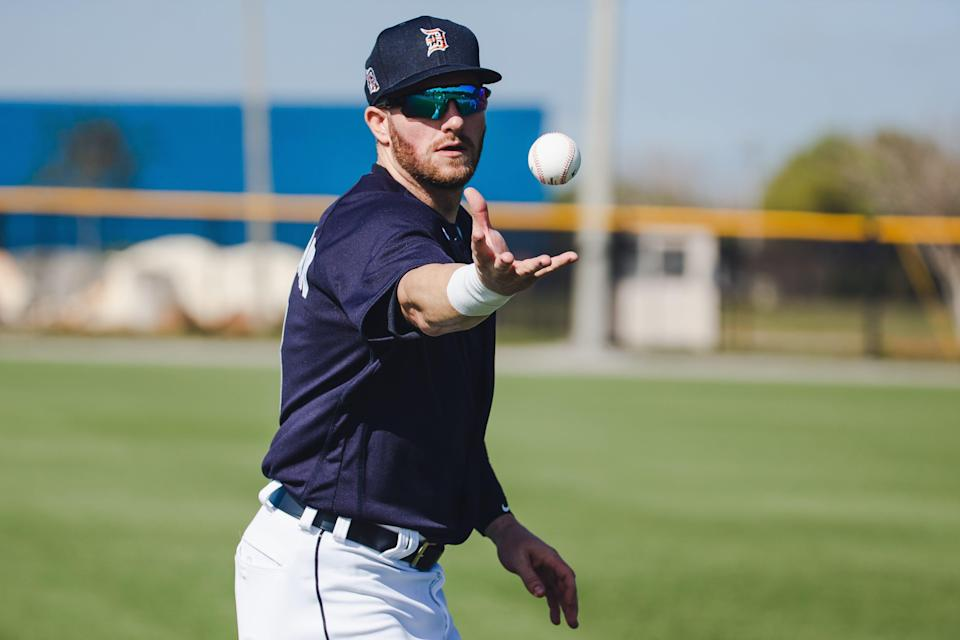 Tigers outfielder Robbie Grossman plays catch at Joker Marchant Stadium in Lakeland, Florida, on Monday, Feb. 22, 2021.