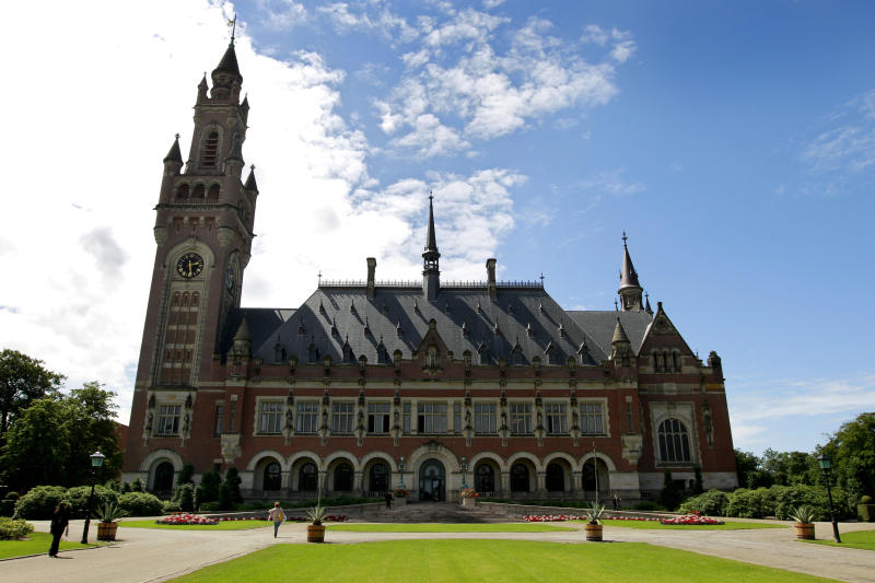"""The Peace Palace, seat of the International Court of Justice in The Hague, Netherlands, Friday, July 20, 2012. The United Nations' highest court has ordered Senegal to prosecute former Chadian dictator Hissene Habre on torture charges """"without further delay"""" if the country does not extradite him to Belgium. Habre is accused of torturing hundreds of his opponents to death during his 1982-1990 rule in the Central African nation before fleeing to Senegal. (AP Photo/Vincent Jannink)"""