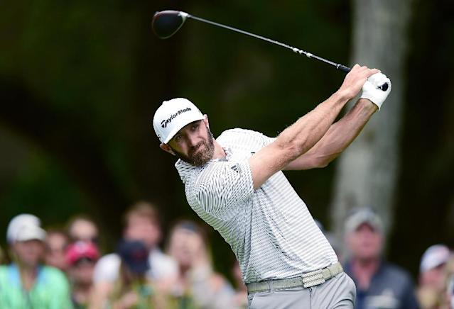 Top-ranked Dustin Johnson fired a three-under par 68 to seize a one-stroke lead after Saturday's third round of the US PGA Heritage tournament (AFP Photo/Jared C. Tilton)
