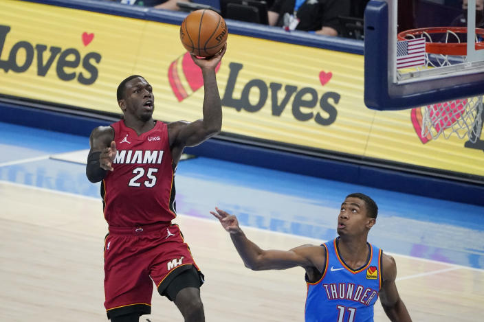 Miami Heat guard Kendrick Nunn (25) goes up for a shot in front of Oklahoma City Thunder guard Theo Maledon (11) in the second half of an NBA basketball game Monday, Feb. 22, 2021, in Oklahoma City. (AP Photo/Sue Ogrocki)