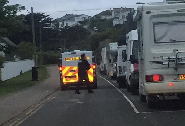 Police gave people who had camped in Newquay, Cornwall, an early morning wake-up call. (SWNS)