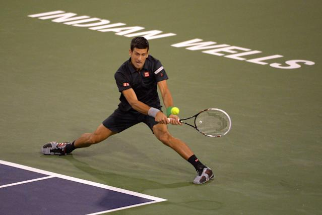 Novak Djokovic, of Serbia, returns a shot to Victor Hanescu, of Romania, during their match at the BNP Paribas Open tennis tournament, Sunday, March 9, 2014, in Indian Wells, Calif. (AP Photo/Mark J. Terrill)