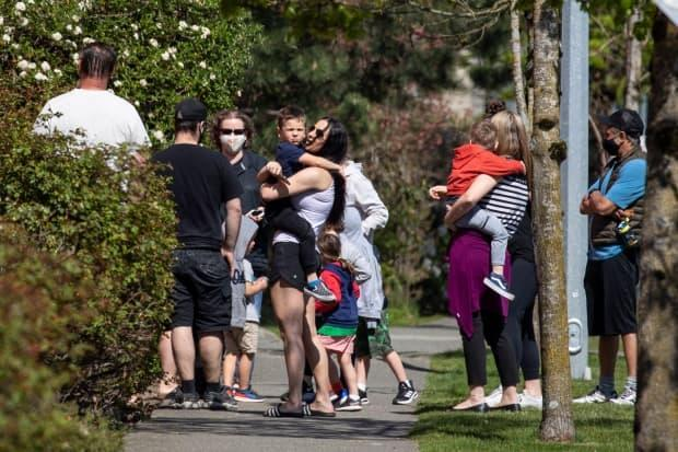 Parents and guardians pick up their children from a daycare attached to the Langley Sportplex where a fatal shooting occurred early in the morning in Langley, British Columbia on Wednesday, April 21, 2021.