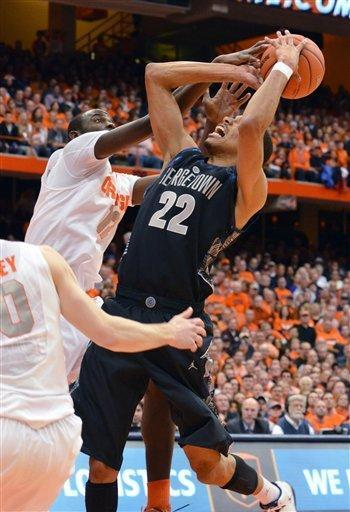 Syracuse's Baye Moussa Keita, left, rejects a shot by Georgetown's Otto Porter during the first half in an NCAA college basketball game in Syracuse, N.Y., Saturday, Feb. 23, 2013. (AP Photo/Kevin Rivoli)