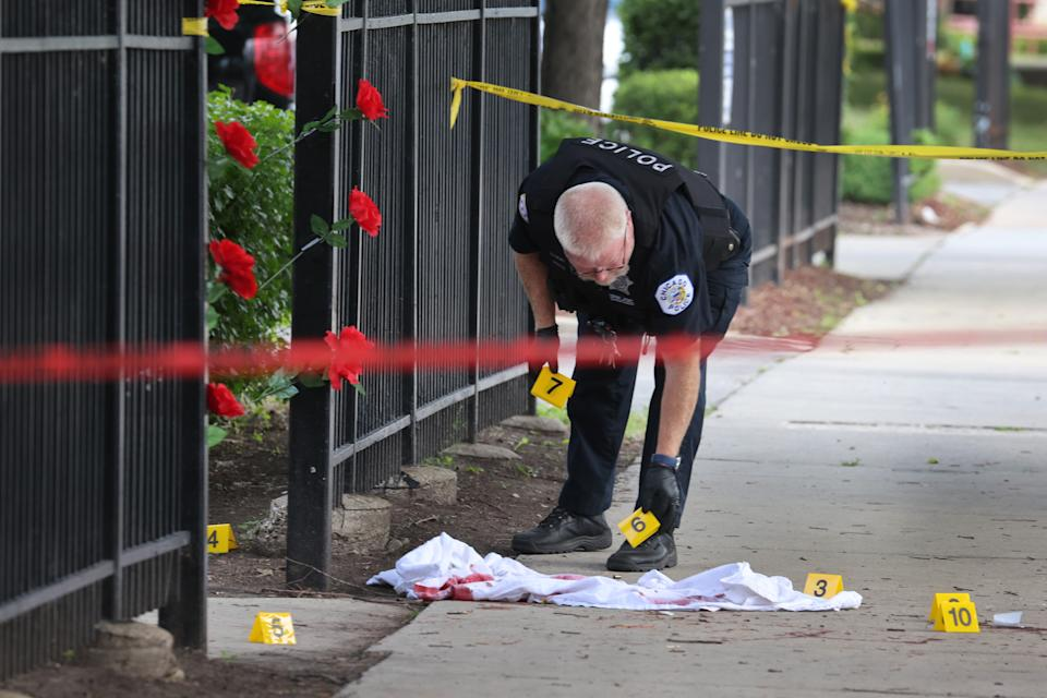 Police investigate a crime scene where three people were shot at the Wentworth Gardens housing complex in the Bridgeport neighborhood on June 23, 2021 in Chicago, Illinois. (Scott Olson/Getty Images)