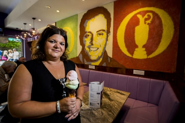 Daniela Morelli, of ice cream shop Morelli's in front of a special commissioned art piece of the 2018 The Open winner Francesco Molinari using 20kg of ice-cream sprinkles