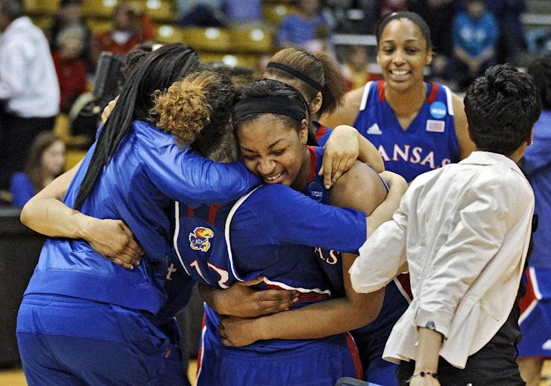 Kansas players celebrate after defeating South Carolina 75-69 in a second-round game in the women's NCAA college basketball tournament, Monday, March 25, 2013, in Boulder, Colo. (AP Photo/ Brennan Linsley)