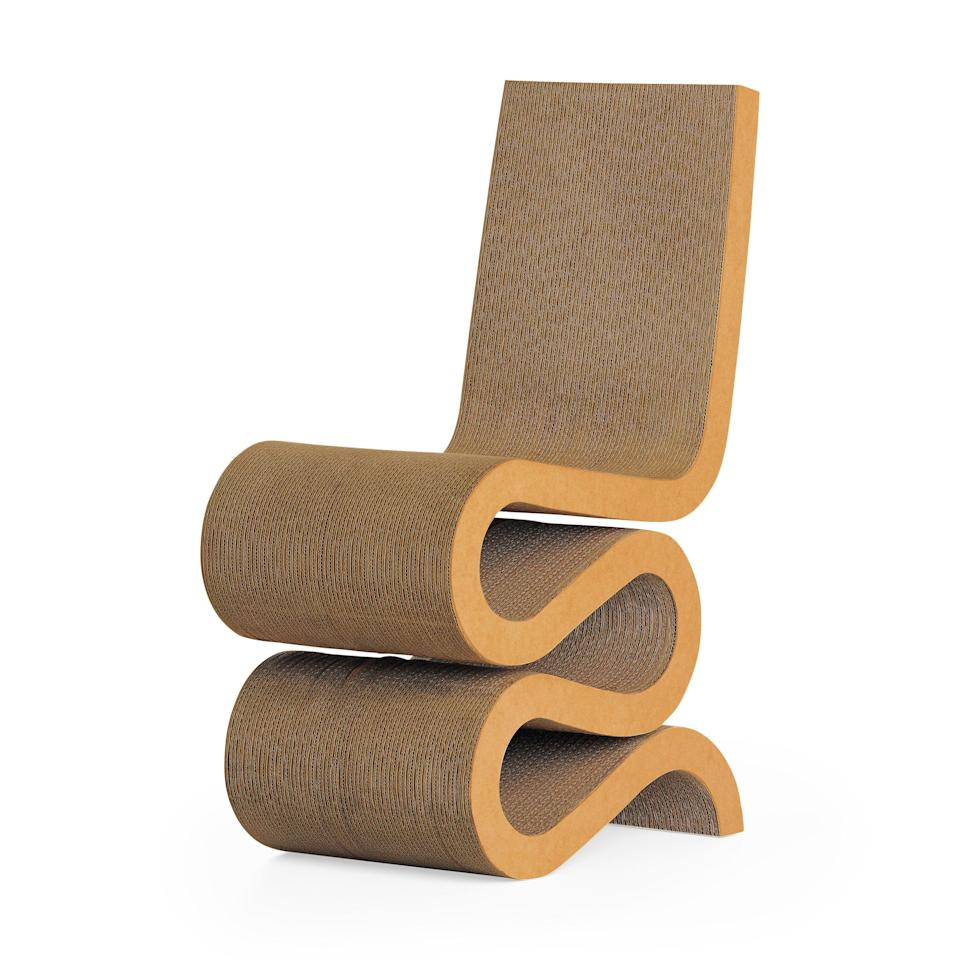 """<p><strong>Frank Gehry</strong></p><p>moma.org</p><p><strong>$1230.00</strong></p><p><a href=""""https://store.moma.org/furniture/chairs/gehry-wiggle-side-chair/5598-801229.html"""" rel=""""nofollow noopener"""" target=""""_blank"""" data-ylk=""""slk:Shop Now"""" class=""""link rapid-noclick-resp"""">Shop Now</a></p><p>In the 1970s, architect Frank Gehry began to experiment with scrap cardboard, an exercise that resulted in a collection of groundbreaking paper furniture. By alternating the cardboard's corrugation, Gehry was able to create stacks of it strong enough to support a human. The Wiggle's serpentine S-shape stands in contrast to its rough material. </p>"""