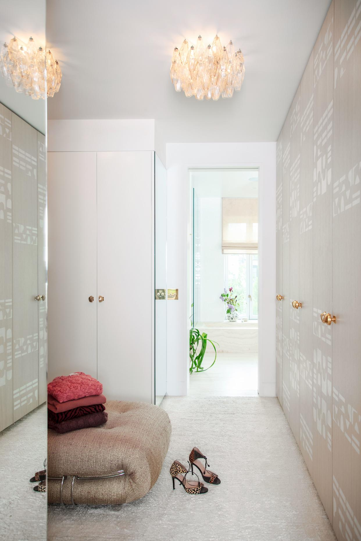 """<div class=""""caption""""> A hand-painted stencil covers the dressing room doors. 1950s Venini light fixtures. </div>"""
