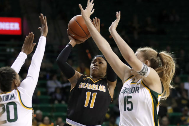 Baylor's Juicy Landrum (20) and Lauren Cox (15) defend as Grambling State guard Ariel Williams (11) shoots in the first half of an NCAA college basketball game in Waco, Texas, Friday, Nov. 8, 2019. (AP Photo/Tony Gutierrez)