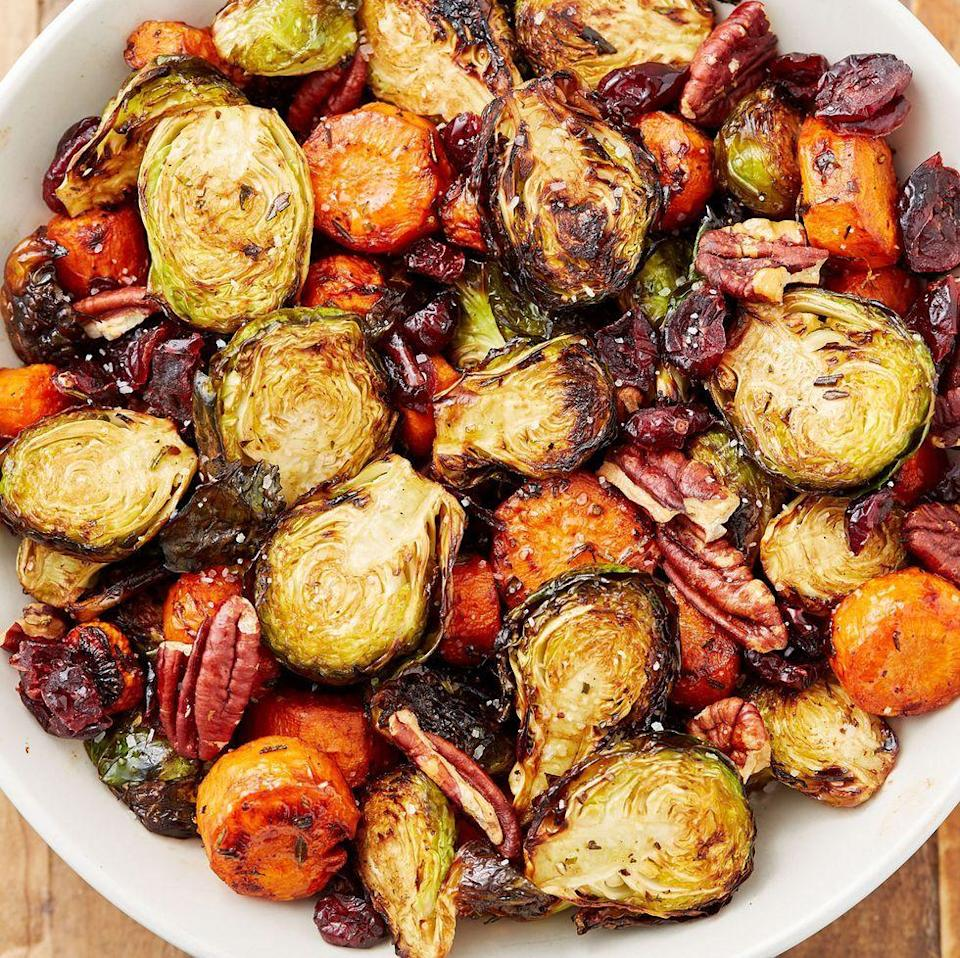 """<p>A great addition to your Sunday roast dinner. The dried cranberries add a tartness while the pecans add an extra crunch for a perfect side dish. We use Brussels sprouts and carrots in our medley, but feel free to add extra vegetables or swap in some of your favourites.</p><p>Get the <a href=""""https://www.delish.com/uk/cooking/recipes/a28934240/holiday-roasted-vegetables-recipe/"""" rel=""""nofollow noopener"""" target=""""_blank"""" data-ylk=""""slk:Roasted Vegetables"""" class=""""link rapid-noclick-resp"""">Roasted Vegetables</a> recipe.</p>"""