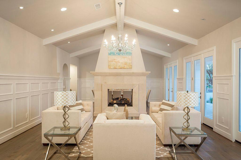 <p>Sitting down to chat fireside is a serene experience in this chic living room.</p>