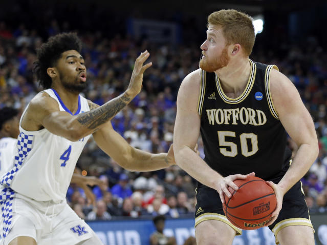 Wofford's Matthew Pegram (50) looks for a shot against Kentucky's Nick Richards (4) during the first half of a second-round game in the NCAA mens college basketball tournament in Jacksonville, Fla., Saturday, March 23, 2019. (AP Photo/Stephen B. Morton)