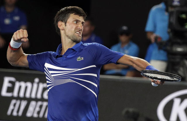 Serbia's Novak Djokovic celebrates after winning a point against United States' Mitchell Krueger during their first round match at the Australian Open tennis championships in Melbourne, Australia, Tuesday, Jan. 15, 2019. (AP Photo/Kin Cheung)