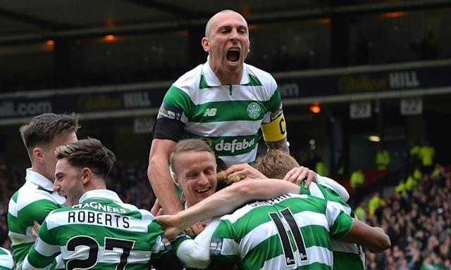 "<span class=""element-image__caption"">Scott Sinclair, No11, is congratulated on scoring Celtic's second goal during their Scottish Cup semi-final victory against Rangers at Hampden Park.</span> <span class=""element-image__credit"">Photograph: Mark Runnacles/Getty Images</span>"