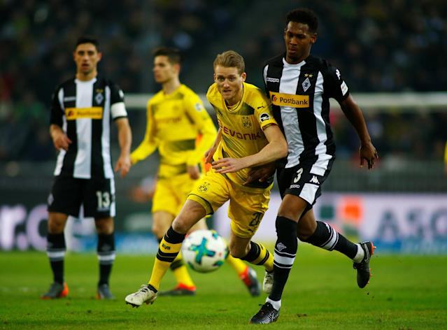 Soccer Football - Bundesliga - Borussia Moenchengladbach vs Borussia Dortmund - Borussia-Park, Moenchengladbach, Germany - February 18, 2018 Borussia Dortmund's Andre Schurrle in action with Borussia Monchengladbach's Reece Oxford REUTERS/Thilo Schmuelgen DFL RULES TO LIMIT THE ONLINE USAGE DURING MATCH TIME TO 15 PICTURES PER GAME. IMAGE SEQUENCES TO SIMULATE VIDEO IS NOT ALLOWED AT ANY TIME. FOR FURTHER QUERIES PLEASE CONTACT DFL DIRECTLY AT + 49 69 650050