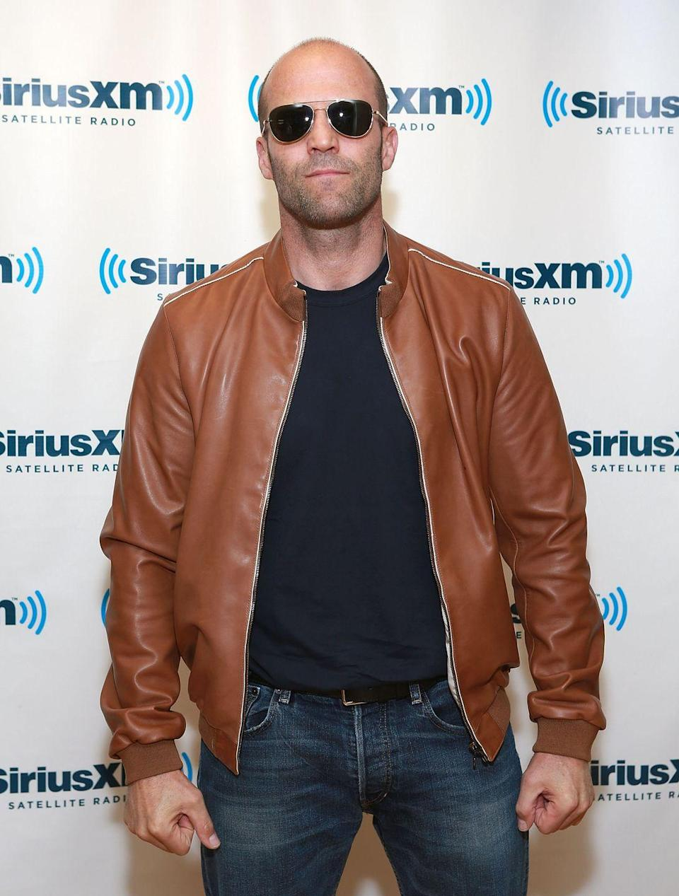 "<p>Fists clenched, jaw tight, despite being clad in leather, Jason Statham is surely flexing as he visits the Sirius XM studios in 2013. Why not? The action star puts in hard work to <a href=""https://www.menshealth.com/fitness/g21070508/jason-statham-instagram/"" rel=""nofollow noopener"" target=""_blank"" data-ylk=""slk:achieve his physique"" class=""link rapid-noclick-resp"">achieve his physique</a>.</p>"