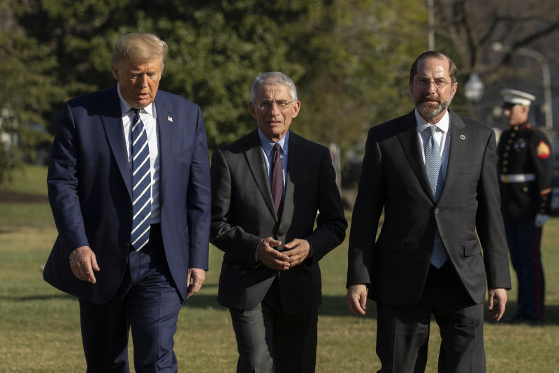 President Donald Trump with Department of Health and Human Services Secretary Alex Azar, right, and Director of the National Institute of Allergy and Infectious Diseases at the National Institutes of Health Anthony Fauci, walk on the South Lawn, Tuesday, March 3, 2020, in Washington, as they arrive at the White House from a visit to the National Institutes of Health's Vaccine Research Center in Bethesda, Md. (AP Photo/Manuel Balce Ceneta)
