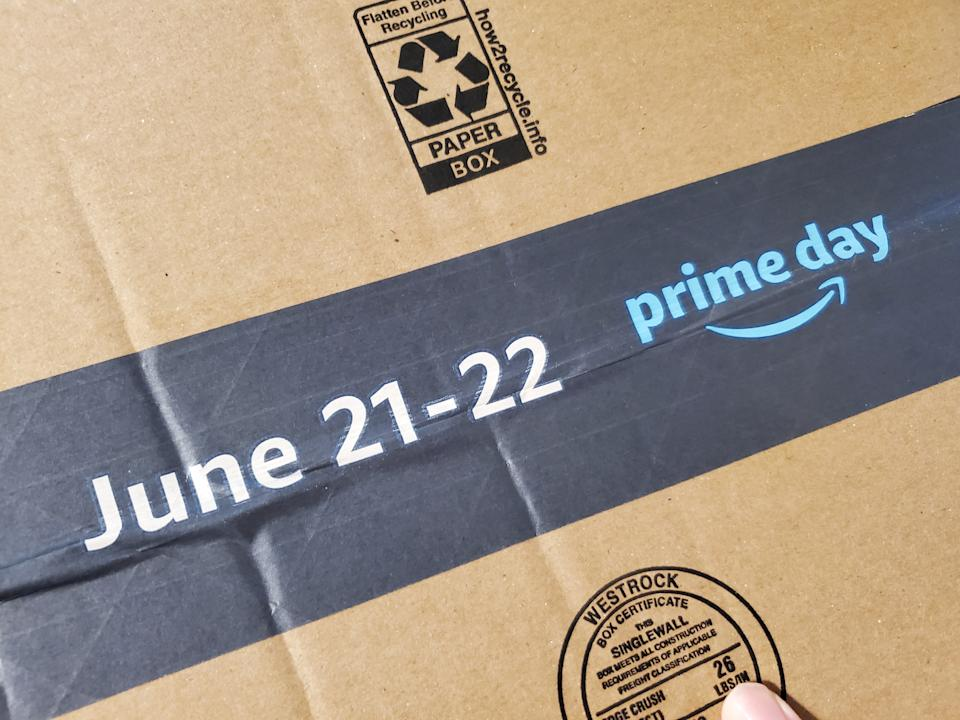 Close-up of packing tape on Amazon shipping box, with logo for Prime Day 2021