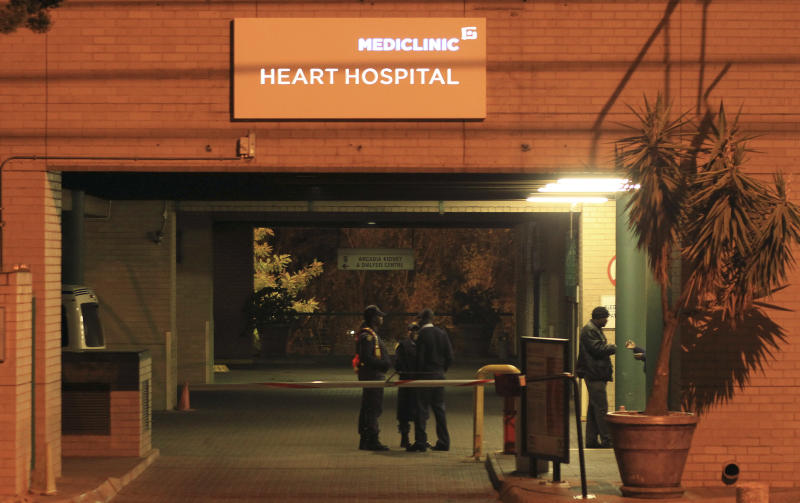 Police officers stand outside the main entrance of the Mediclinic Heart Hospital where former South African President Nelson Mandela is being treated in Pretoria, South Africa Sunday, June 23, 2013. Mandela's health has deteriorated and he is now in critical condition, the South African government said Sunday. (AP Photo/Themba Hadebe)