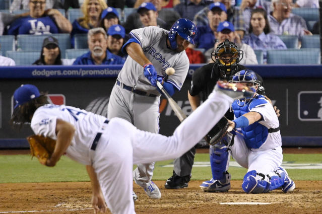 Toronto Blue Jays' Rowdy Tellez hits a solo home run off Los Angeles Dodgers relief pitcher Kenley Jansen, foreground, during the ninth inning of a baseball game Wednesday, Aug. 21, 2019, in Los Angeles. (AP Photo/Mark J. Terrill)