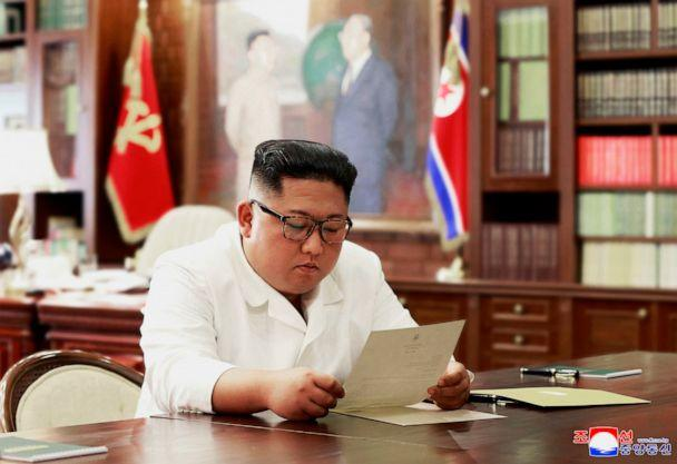 PHOTO: This file undated and unlocated picture released from North Korea's official Korean Central News Agency on June 23, 2019, shows North Korean leader Kim Jong Un reading a personal letter from U.S. President Donald Trump. (Korean Central News Agency via AP, FILE)
