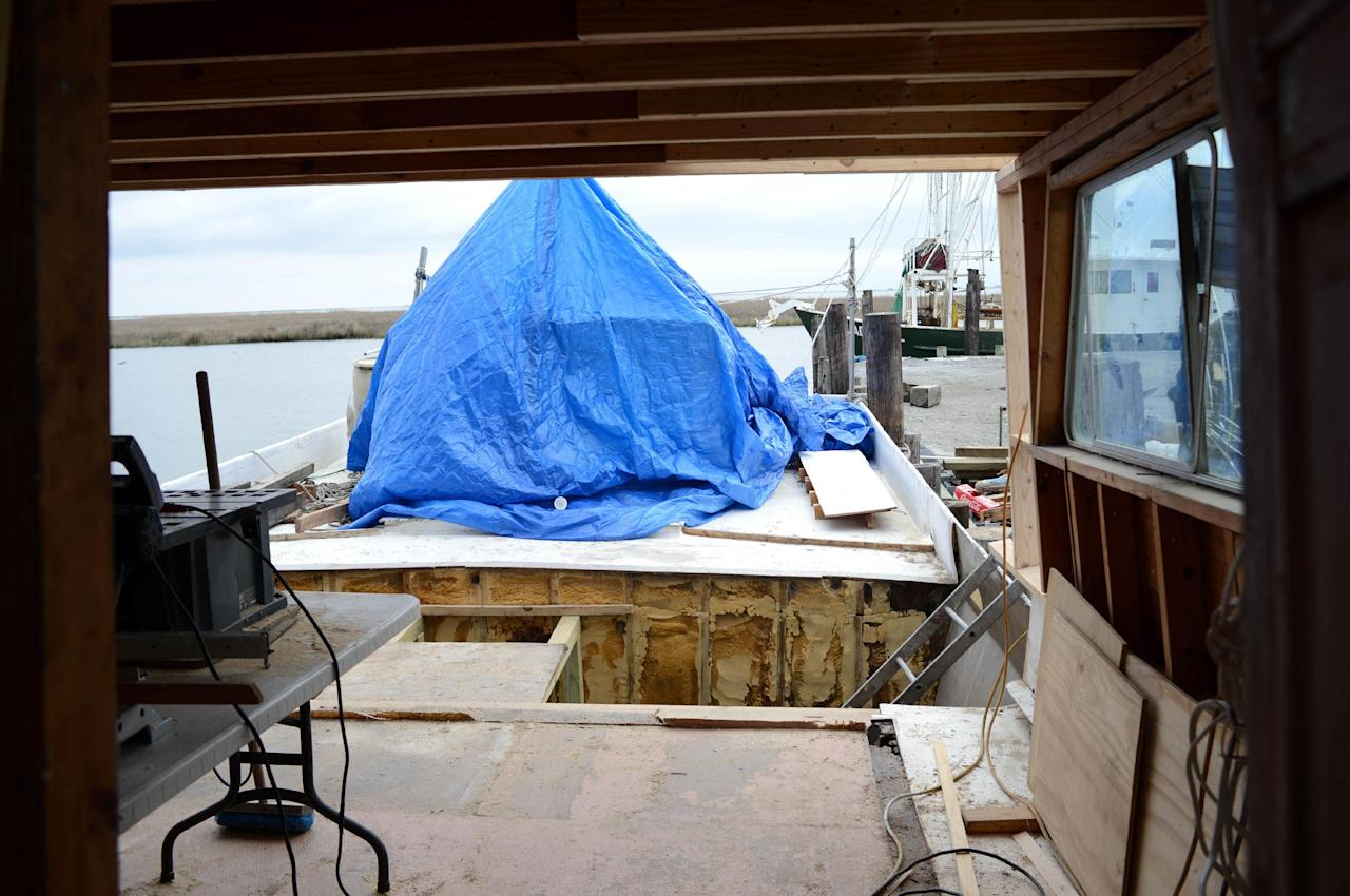 Bert Ducote's boat is being rebuilt at the Lake Catherine Marina in New Orleans, Friday, March 7, 2014. (AP Photo/Andrea Mabry)