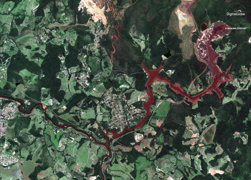 This Jan. 29, 2019 satellite image provided by DigitalGlobe shows mud flooding an area days after a mining company's dam collapsed on Jan. 25, near Brumadinho, Brazil. As search-and-recovery efforts continued, authorities also worked to slow the reddish-brown mud that was heading down a small river with high concentrations of iron oxide, threatening to contaminate a much larger waterway that provides drinking water to communities in five of the country's 26 states. (DigitalGlobe, a Maxar company via AP)