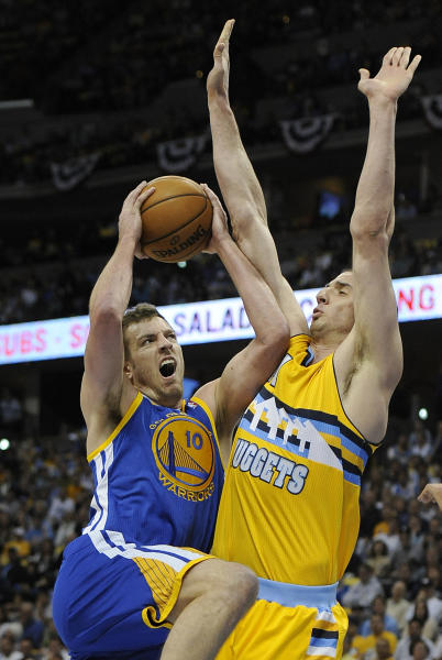 Golden State Warriors forward David Lee, left, drives the lane against Denver Nuggets center Kosta Koufos, right, in the first quarter of Game 1 in the first round of the NBA basketball playoffs on Saturday, April 20, 2013, in Denver. (AP Photo/Chris Schneider)